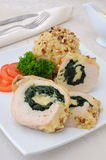 Chicken roulade stuffed with spinach and cheese Stock Image
