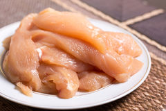 Sliced chicken white meat breasts filet on the plate.  Stock Images
