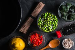 Sliced chili, frozen peas in a bowl of buckwheat noodles Royalty Free Stock Images