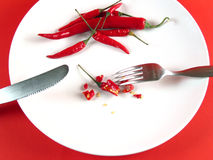 Sliced chili on plate (serie). Little sliced chilli on plate Stock Photo