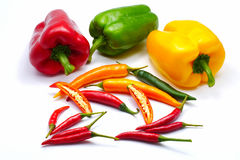 Sliced chilli bell and bird& x27;s eye pepper isolated owhite background Royalty Free Stock Image