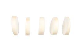 Sliced chinese radishes isolated on white. Background Royalty Free Stock Photos