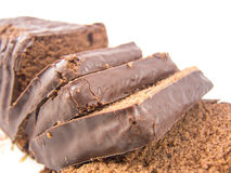 Sliced choco cake. On a white background Royalty Free Stock Image