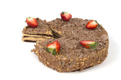 Sliced chocolate cake with strawberries on white Stock Images