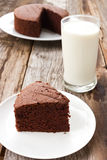 Sliced chocolate cake on white plate. Stock Photos