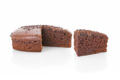 Sliced chocolate fudge cake Royalty Free Stock Images