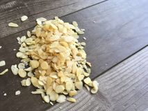 Sliced/chopped Almonds on a Wooden Background Stock Photography