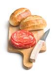 Sliced chorizo salami and buns Stock Photography