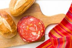 Sliced chorizo salami and buns Stock Photo