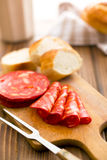 Sliced chorizo salami on cutting board Stock Photography