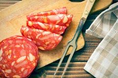 Sliced chorizo salami with fork Royalty Free Stock Photos
