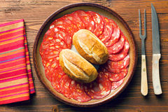 Sliced chorizo salami on plate Royalty Free Stock Photography