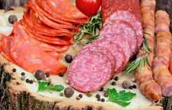 Sliced of chorizo, salami, sausages with herbs Stock Photos