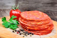 Sliced of chorizo on a wood board Royalty Free Stock Image