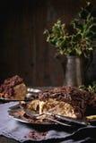Sliced christmas chocolate yule log Royalty Free Stock Images