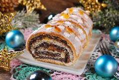 Sliced christmas poppy seed cake with icing and snowflake sprink Stock Photo