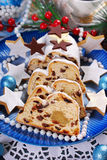 Sliced christmas stollen cake on blue plate Royalty Free Stock Image
