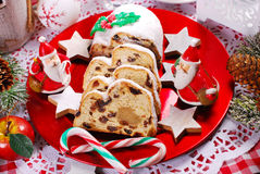 Sliced christmas stollen cake on red plate Royalty Free Stock Images