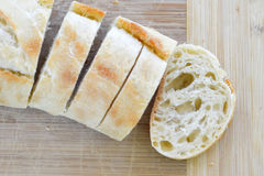 Fresh baked ciabatta. Freshly baked and sliced loaf of ciabatta bread Stock Image