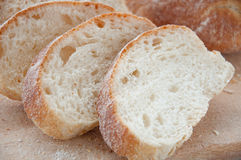 Sliced ciabatta bread on the board Stock Image