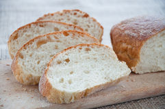 Sliced ciabatta bread on the board Royalty Free Stock Images