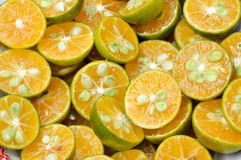 Sliced citrus fruit Stock Photos