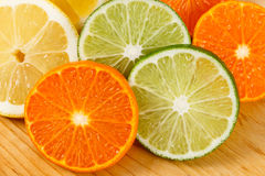 Sliced Citrus Fruit, Limes, Lemons and Oranges Royalty Free Stock Photo