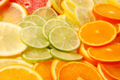 Sliced citrus fruits. Colorful and juicy sliced citrus fruits stock photography