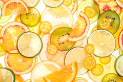Sliced citrus fruits background. Royalty Free Stock Photography