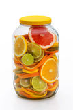 Sliced citrus fruits in a jar. Royalty Free Stock Photography