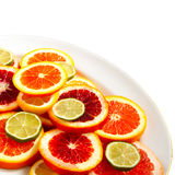 Sliced citrus fruits on plate Stock Photos