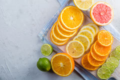 Sliced citrus fruits on sstone background Stock Images