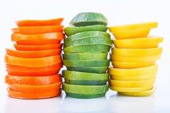 Sliced citrus: oranges, mandarines, lemons, limes, sweetie, grapefruits, witch's broom close-up macro Stock Images