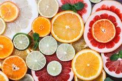 Sliced citrus: oranges, mandarines, lemons, limes, sweetie, grapefruits, witch's broom close-up macro Royalty Free Stock Photo