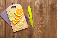 Sliced citruses on cutting board Stock Image