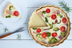 Sliced classic quiche lorraine pie with broccoli, cheese and tomatoes Royalty Free Stock Photography