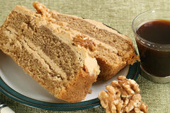 Sliced coffee and walnut cake Stock Photography