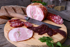 Sliced cold cuts and knife Stock Image