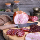Sliced cold meats on a cutting board Stock Images