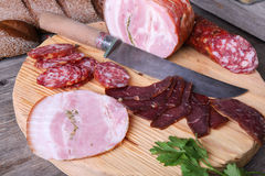Sliced cold meats on a cutting board Royalty Free Stock Photo