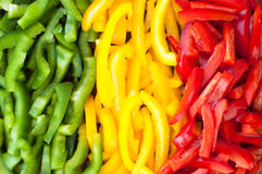 Sliced colourful paprika peppers background.  Stock Photo