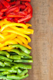 Sliced colourful paprika peppers background.  Royalty Free Stock Image