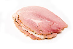 Sliced cooked ham. Three slices of delicious cooked ham isolated on white studio background Stock Image