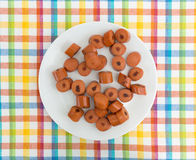 Sliced cooked hot dogs on a white plate Stock Image