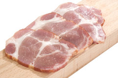 Sliced cooked pork neck on a cutting board Stock Image