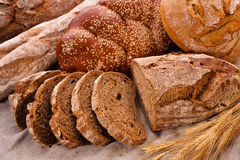 Sliced country-styled brown bread Stock Photos
