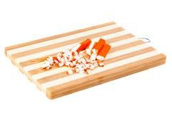 Sliced crab sticks on  cutting board Stock Photos