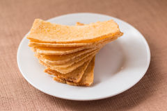 Sliced crispy bread in white ceramic dish. Royalty Free Stock Images