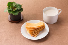 Sliced crispy bread in white ceramic dish. Royalty Free Stock Photography