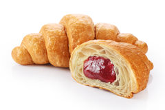 Sliced croissant with strawberry jam. Isolated on white background stock photo